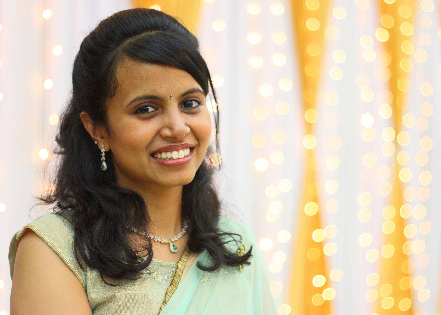 A portrait shot of Mahima Mahesh with a nice bokeh background