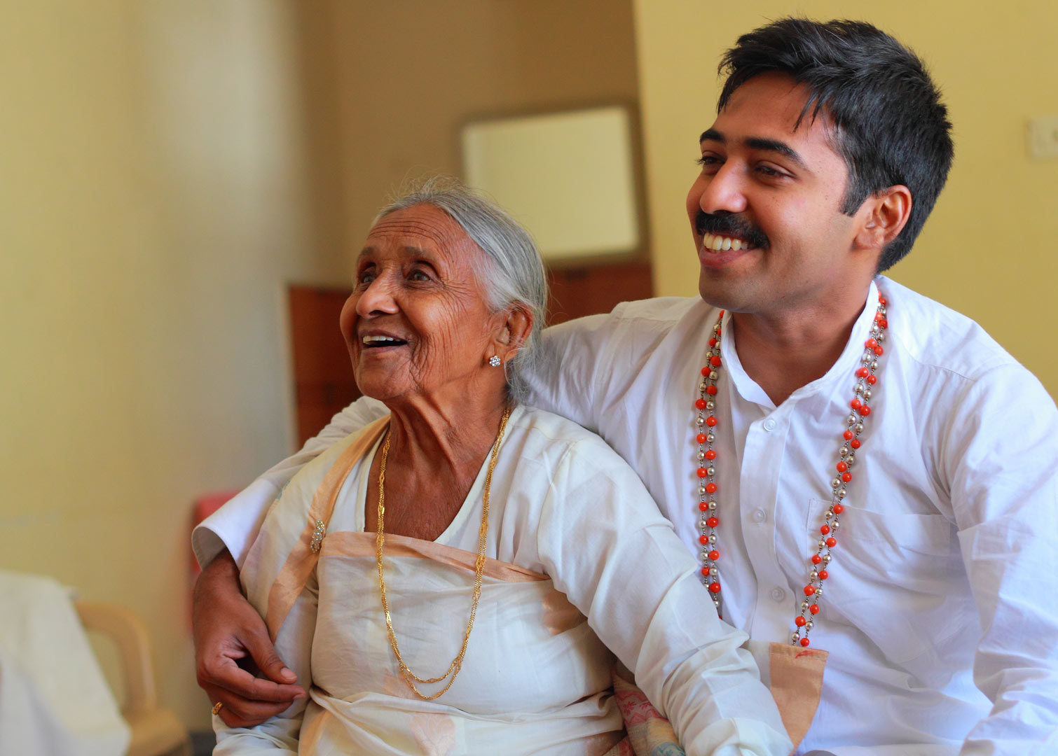 Candid shot of the Bridegroom with his grandmother on the day of the wedding